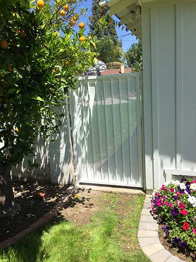 Cute White Steel Gate on Side of Home