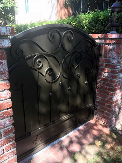 Steel Gate Mounted to Brick Wall