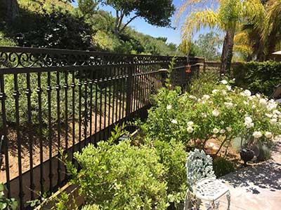 Custom Wrought Iron Fence in Back Yard