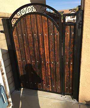 Metal Gate With Dark Stained Wood